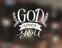 Hand lettering God loves you, made a white font. Stock Image