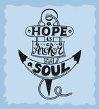 Hand lettering A Hope is anchor for the soul on a blue background. Royalty Free Stock Image