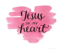 Hand lettering Jesus in my heart on watercolor backgroup.