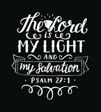 Hand lettering The Lord is my light and my salvation on black background. Hand lettering The Lord is my light and my salvation. Biblical background. Christian Stock Photos