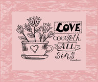 Hand lettering Love covers all sins. Is made near the flower pot. Biblical background. Christian poster Stock Photography