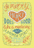 Hand lettering Merry heart does good like medicine, but a crushed spirit dries up the bones. Royalty Free Stock Photo