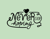 Hand lettering Never stop hoping with heart. Motivational quotes. Poster. Biblical background Stock Images