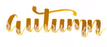 `Autumn` hand lettering inscription made with liquid watercolor brush pen in golden brown with flourishes and white gel doodles stock illustration