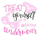 Hand lettering quote - treat yourself to delicious underwear - with lace panty and bra Royalty Free Stock Photos