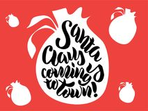 Hand lettering `Santa Claus is coming to town` Royalty Free Stock Images