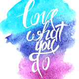 Hand lettering with text - love what you do. Hand lettering with text -  love what you do.Text inside watercolor background.Vector illustration Royalty Free Stock Image