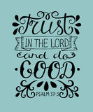 Hand lettering Trust in the Lord and do good. Stock Photos