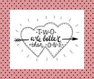 Hand lettering Two is better than one made in two fused hearts. Royalty Free Stock Photos