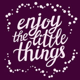 Hand lettering  typography poster Enjoy the little things Royalty Free Stock Image