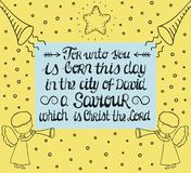 Hand lettering For unto you is born in the city of David a Saviour, which is Christ the Lord with star and angels. Stock Images