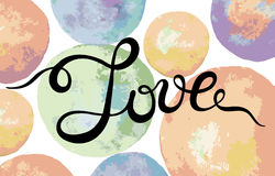 Hand lettering word Love on colorul watercolor abstract backgrou Royalty Free Stock Image