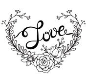 Hand lettering word Love with floral wreath in heart form Royalty Free Stock Images