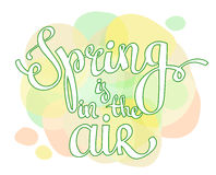 Hand lettering  words Spring is in the air Stock Image