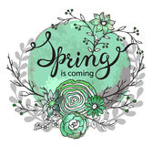 Hand lettering words Spring is coming with floral wreath Stock Images