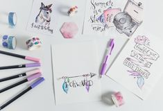 Hand lettering workspace with quotes. Workspace artist on white background. paint, palette, watercolor, brushes, paper. Top view lettering. hand lettering quotes stock photo