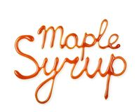 Hand lettering written by liquid maple syrup. Isolated on white background royalty free stock photo