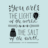 Hand lettering You the light of the world and the salt of the earth. Biblical background. Christian poster. New Testament. Card Royalty Free Stock Photography