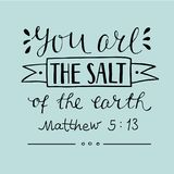 Hand lettering You are the salt of the earth. Biblical background. Christian poster. New Testament. Card. Matthew Royalty Free Stock Photo