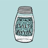 Hand lettering You are the salt of the earth, made on saltcellar. Hand lettering You are the salt of the earth. Biblical background. Christian poster. New Royalty Free Stock Images