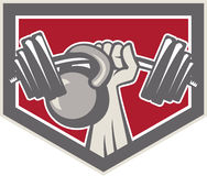 Hand Lifting Barbell and Kettlebell Shield. Illustration of a hand lifting weights barbell kettlebell viewed from front set inside shield crest on isolated Stock Photos