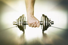 Hand Lifting Dumbbell Stock Images
