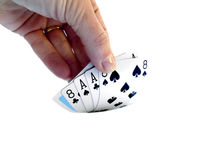 Hand lifting up a Dead man's hand, two-pair poker hand consistin Royalty Free Stock Image