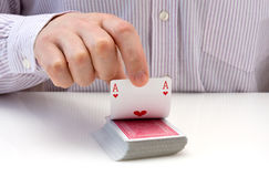 Hand lifting up playing card Royalty Free Stock Image