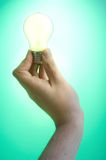 Hand and light bulb Royalty Free Stock Images