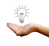 Hand with light bulb. Drawing of light bulb over human hand; isolated on white background; ideas concept Royalty Free Stock Photo
