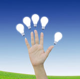 hand with Light bulb Stock Images