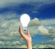 Hand with Light bulb Stock Photos