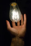 Hand and light bulb Stock Photo