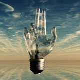 Hand light bulb Stock Photography