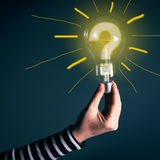 Hand with light bulb and question mark Royalty Free Stock Images