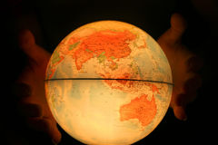 Hand on light globe Royalty Free Stock Photography