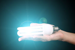 Hand with lightbulb Stock Photo
