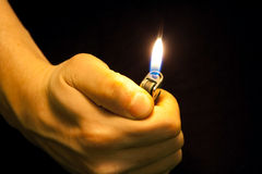 Hand with lighter Royalty Free Stock Photography