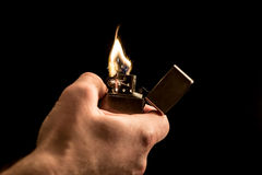Hand and a lighter Stock Photo