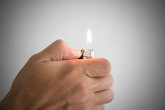 Hand with lighter. A man hand and with lighter Stock Images