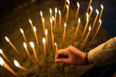 Hand Lighting A Candle Royalty Free Stock Photo