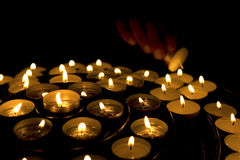 Hand lighting candles Royalty Free Stock Image
