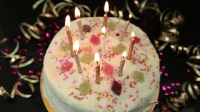 Hand lighting candles on birthday cake Stock Images