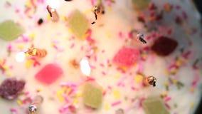 Hand lighting a revolving birthday cake stock video