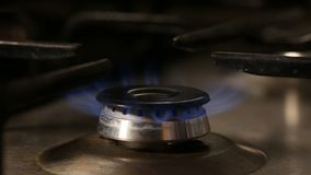 Hand lighting and turning off gas burner -. Close up view stock video