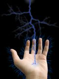 Hand and lightning. On black background Royalty Free Stock Photos
