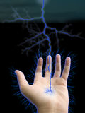 Hand and lightning. On black background Royalty Free Stock Photo