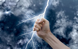 Hand with a lightning. Against the sky stock photo
