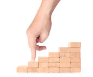 Hand liken business person stepping up  toy staircase Stock Image