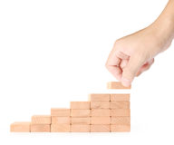 Hand liken business person stepping up  toy staircase. Hand liken business person stepping up a toy staircase Royalty Free Stock Photos